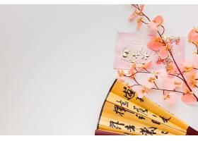 新年粉色花朵扇子背景