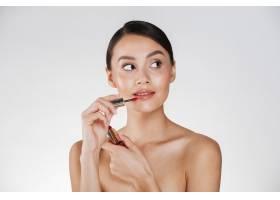美丽的女人肖像皮肤健康在嘴唇涂上红色_6514624