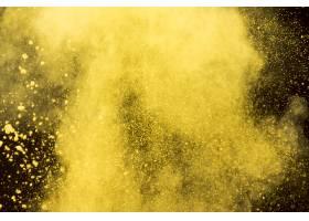黑色背景上的黄色化妆粉云_4912199