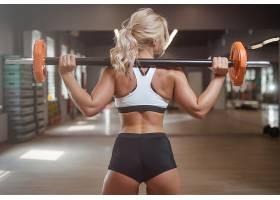 性感举重年轻健身女性背影