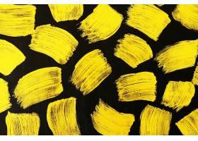 金色黑底刷子笔痕痕迹素材背景