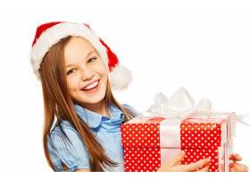 抱着礼物的圣诞节小女孩