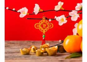新年红色花枝花朵元宝背景