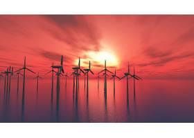 日落的天空映衬着海上的3D风力涡轮机_458813901