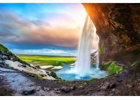 夕阳西下的塞尔雅兰瀑布冰岛美丽的瀑布_1176891501
