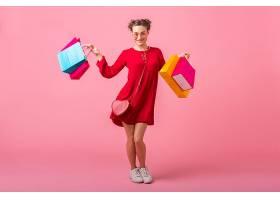 迷人幸福微笑的时尚女性购物狂手持五颜六色_1215269901