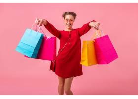 迷人幸福微笑的时尚女性购物狂身着红色新潮_1215319801