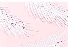 粉色桌子上的三片纸棕榈叶_420932301