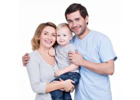 带着小孩看着相机的幸福家庭的肖像与世隔_1155461801
