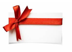 卡片上有红色缎带蝴蝶结在白色背景上隔离_100799501