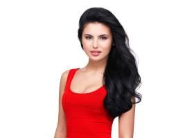 一位身穿红色连衣裙留着棕色长发面带微_1199398101