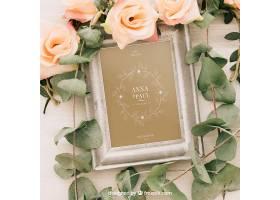 用相框鲜花和树叶制作的婚礼样机_12125900102