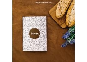 用面包和鲜花制作的书籍封面样机_13589540102
