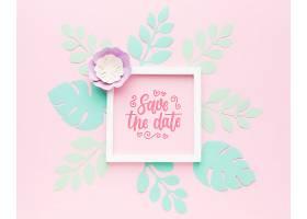 粉色背景上有纸叶的婚礼框架样机_77419450102