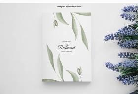 右边有鲜花的书籍封面样机_13589460102