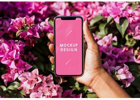 花卉背景下的智能手机样机_37637510102
