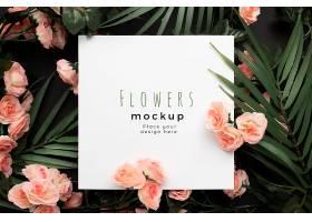 带有棕榈叶和粉红色花朵背景的漂亮样机模板_101482810102