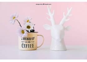 鲜花和鹿雕像的样机_13660910102