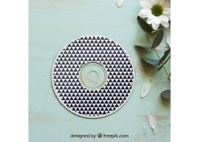 鲜花旁的CD样机_16932120102