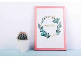 带有装饰性仙人掌的粉色框架样机_41368530102