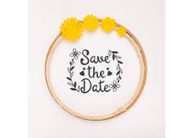 带黄色花朵的圆形框架节省了日期样机_66738310102