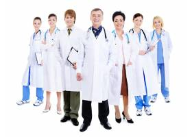 一群成功的医生身着医院礼服站在一起的快乐_10625497