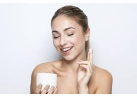 具有美容产品理念的女性前视_10881462