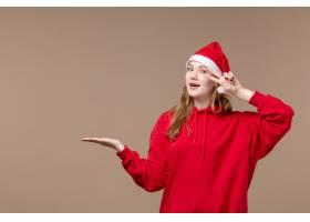 前景圣诞女孩在棕色背景假日新年圣诞节摆姿_11659293