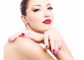 一个性感女人的特写脸修着鲜红的指甲嘴_10878145