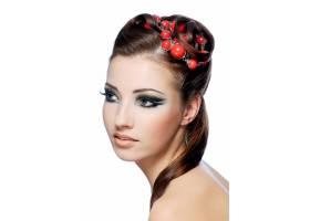 一位富有创意发型和妆容时髦的迷人年轻女_10626087