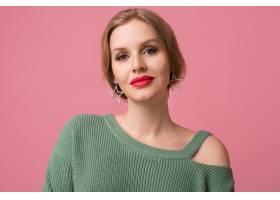 化妆时髦的女人红色的嘴唇绿色的毛衣摆_9629294