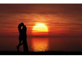 海滩上的情侣日落_99711201
