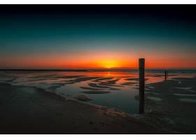 荷兰多姆堡令人叹为观止的日落在海洋中的_10399403