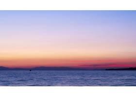 爱琴海上的日落远处的轮船和陆地水希_12311488