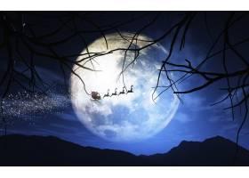 圣诞老人和他的雪橇在月光灿烂的天空中飞翔_3336311