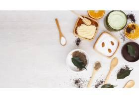 带有复印空间的木桌上身体黄油的俯视图_5701675