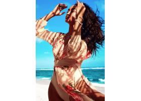 身穿米色连衣裙留着深色长发的美丽女子在_6933296