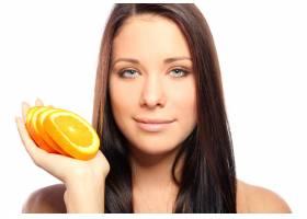 手里拿着橘子的美女_6900274