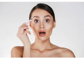 性感的黑发女子的美容肖像发髻在脸上表达_6514603