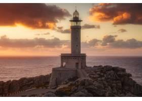 日落时分西班牙加利西亚的蓬塔纳里加灯塔_1294817201