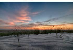 沙滩上令人叹为观止的日落_894404901