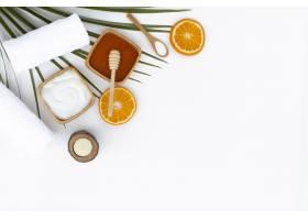 身体黄油蜂蜜和橙色在白色背景上平铺_5691037