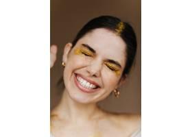 佩戴金色饰品的华丽女模特写迷人的黑发女_12608114