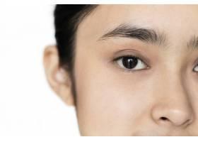 孤立在眼睛上的亚洲年轻女孩肖像特写_2892742