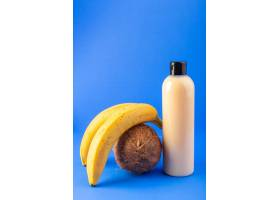 一个正面的奶油色瓶子塑料洗发水罐黑色的_9368013
