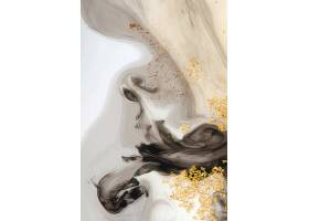 抽象的黑色水彩画和金色闪亮的背景_12459372