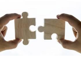 拼图游戏的微距镜头诠释了团队合作的概念_3011763