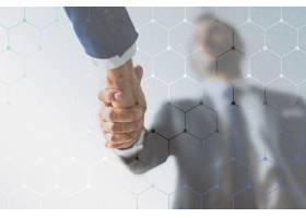 合作伙伴之间的企业业务握手_12193203