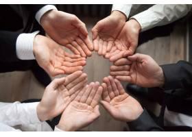 业务团队携手共圆手掌向上成长理念_3953844