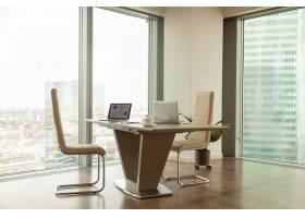 现代公司经理明亮的办公室里的工作场所_3955584